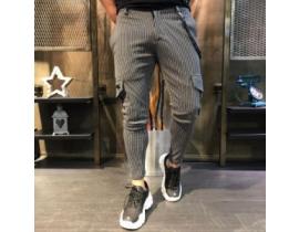 Pantaloni sport in dungi  cu buzunare aplicate